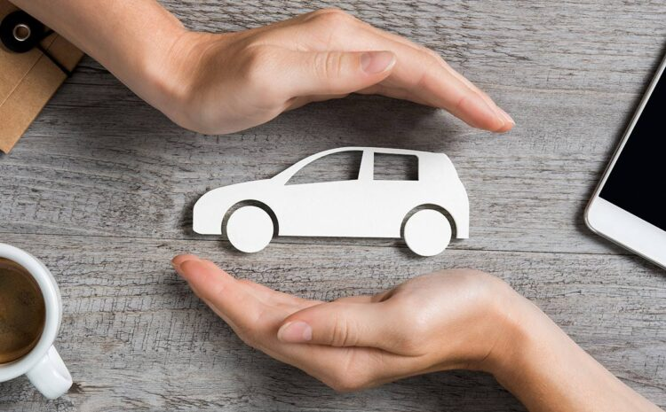 Hands with cardboard car in middle