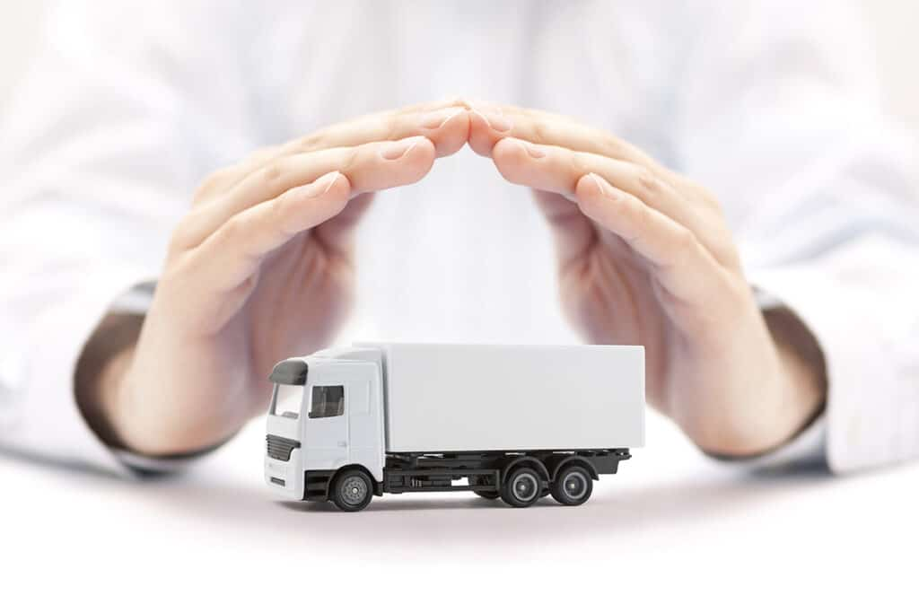Man with hands around commercial truck