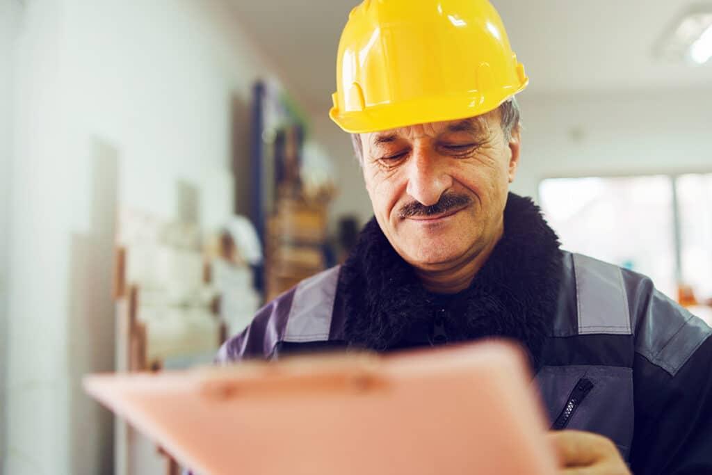 Contractor looking at clipboard