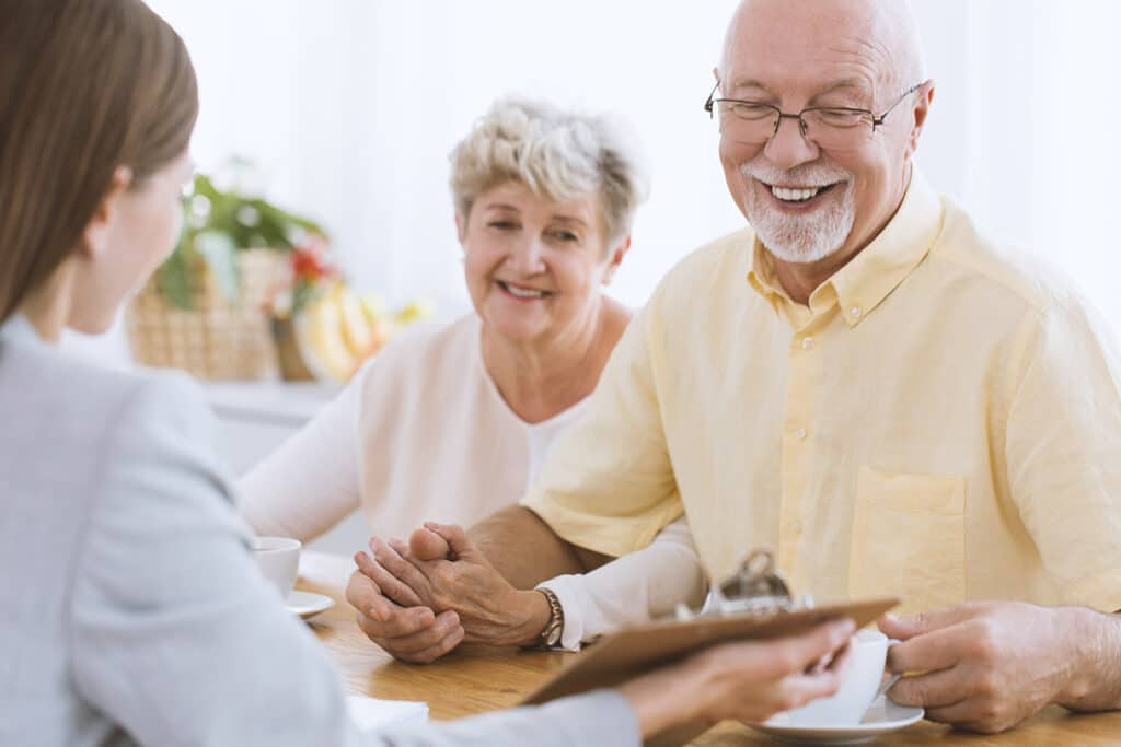 Older couple talking to insurance agent